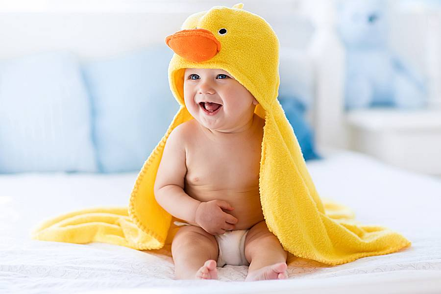 Infant with bright yellow towel