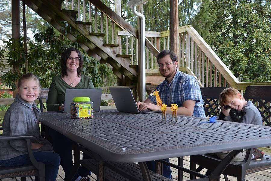 Anna Louise, Johanna, Aaron, and Lars Birkland on their deck in Bridgewater, Virginia
