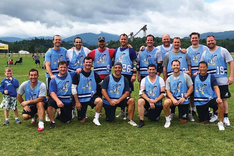 A group photo of lacrosse players in their 30s and 40s
