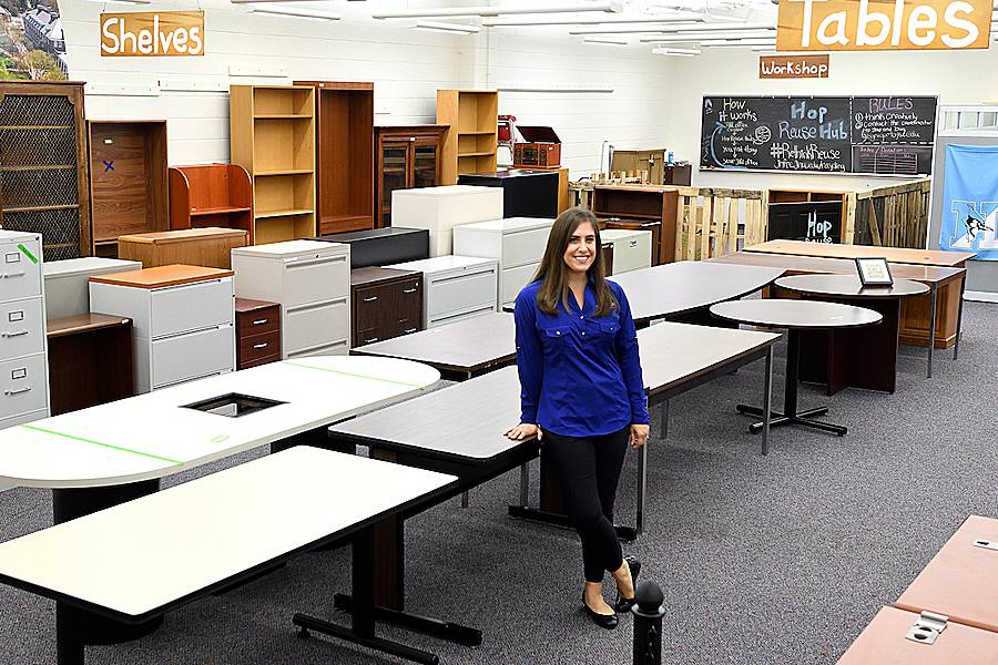 Brigid Gregory in the Hop Reuse Hub, surrounded by tables, file cabinets, and bookcases