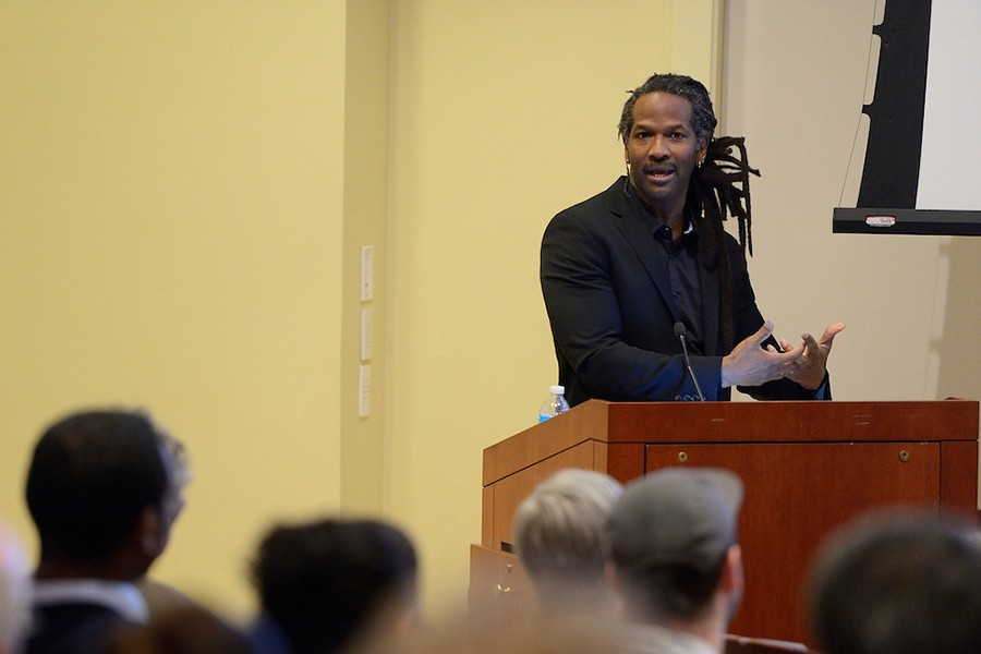 Carl Hart speaks from podium