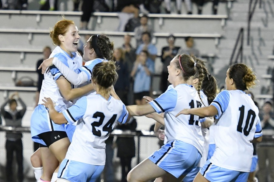 Hopkins women's soccer players celebrate