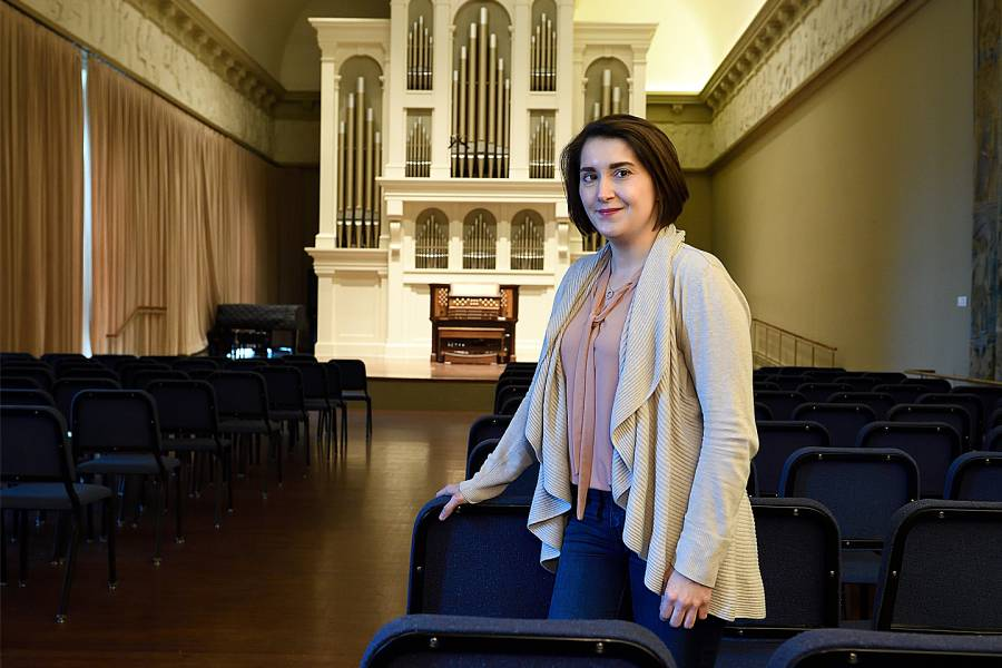 Chelsea Buyalos in the Peabody Conservatory's Griswold Hall, which houses a custom-built Holtkamp organ.