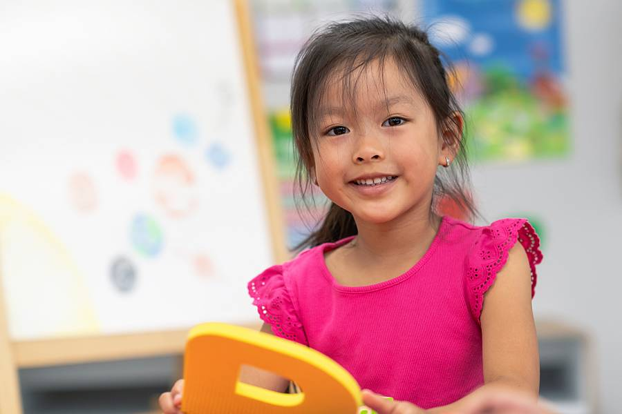 Preschool girl in child care setting