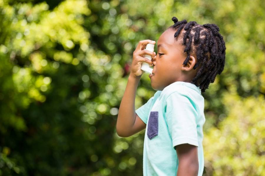 A child uses an inhaler
