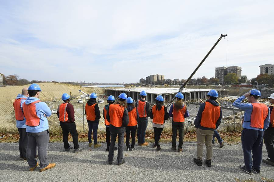 Civil engineering students on a trip to the reservoir at Druid Hill