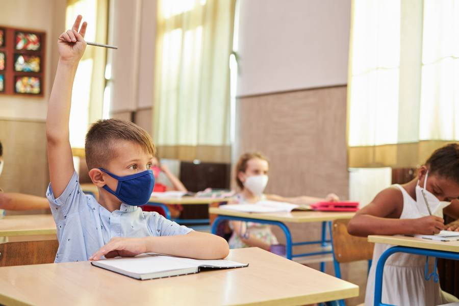 Masked children in a classroom