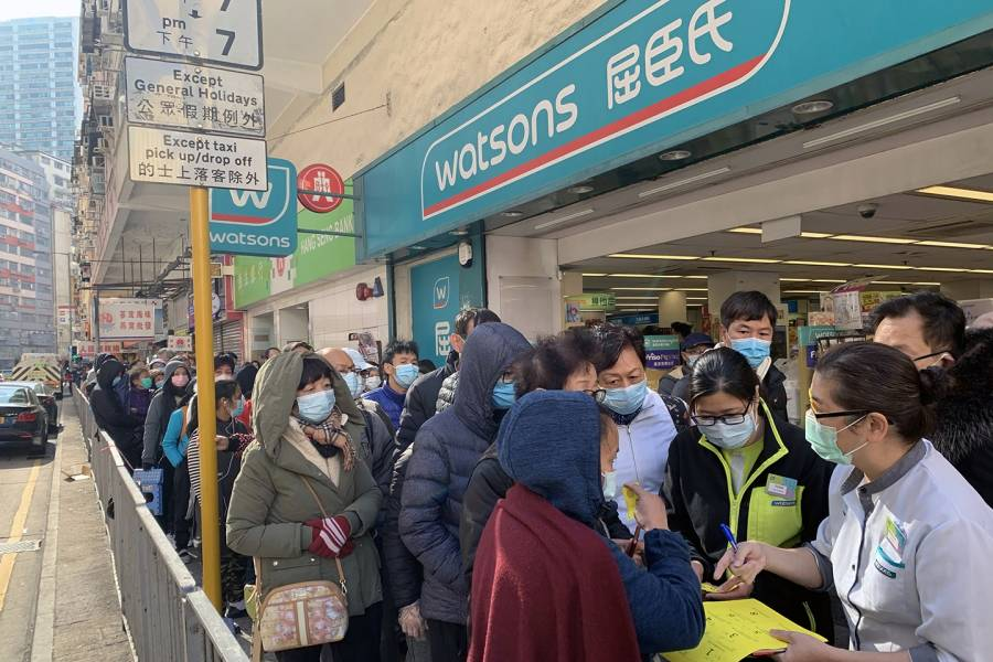 People crowd a pharmacy in Hong Kong