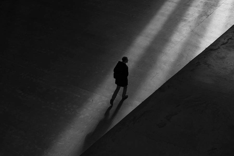 Shadowy figure walks in the shadows