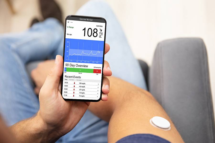 Man checking blood sugar level on smart phone