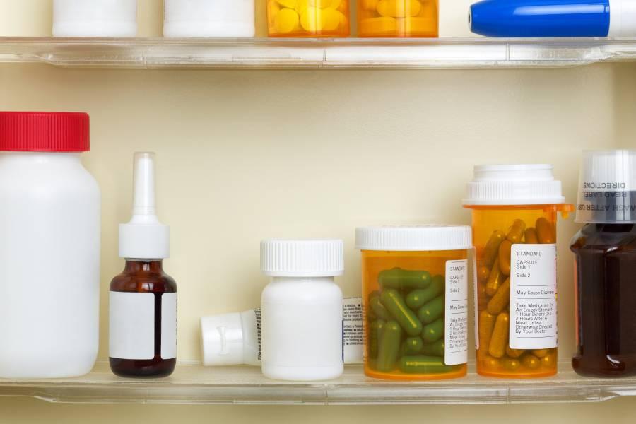 Prescription bottles in a medicine cabinet