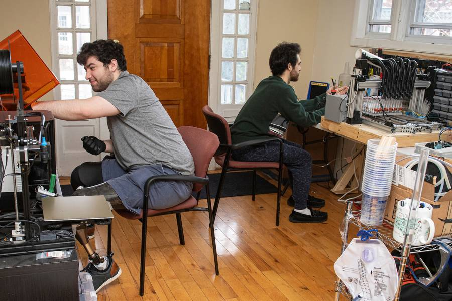 Mark Shiffman and Christopher Shallal work in their home engineering lab