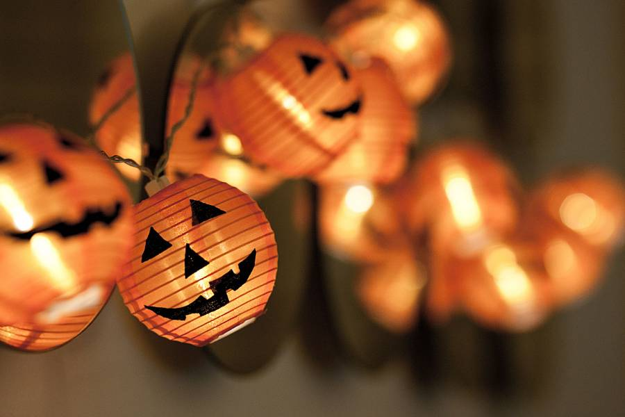 Close-up of a string of pumpkin lights
