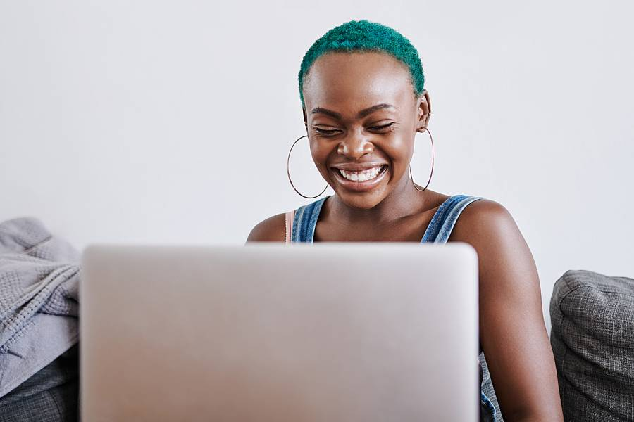 African American woman talking with someone through her computer