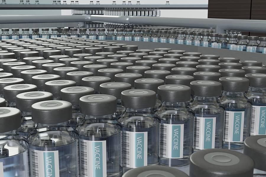 Vials of flu vaccine on a factory conveyer belt