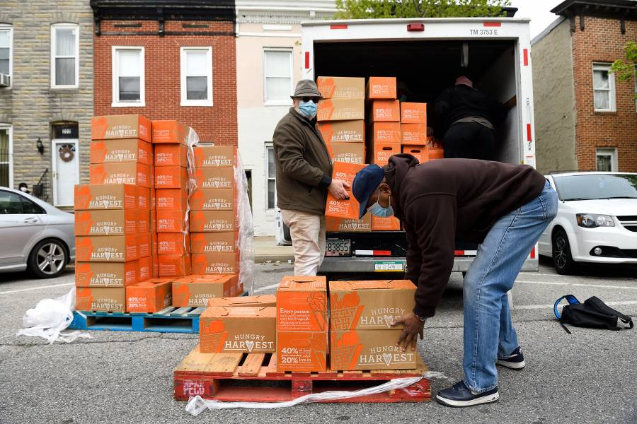 Volunteers deliver boxes of food as part of East Baltimore food distribution initiative