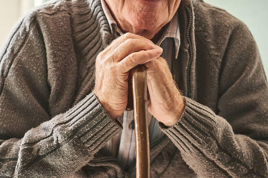 Elderly man with cane