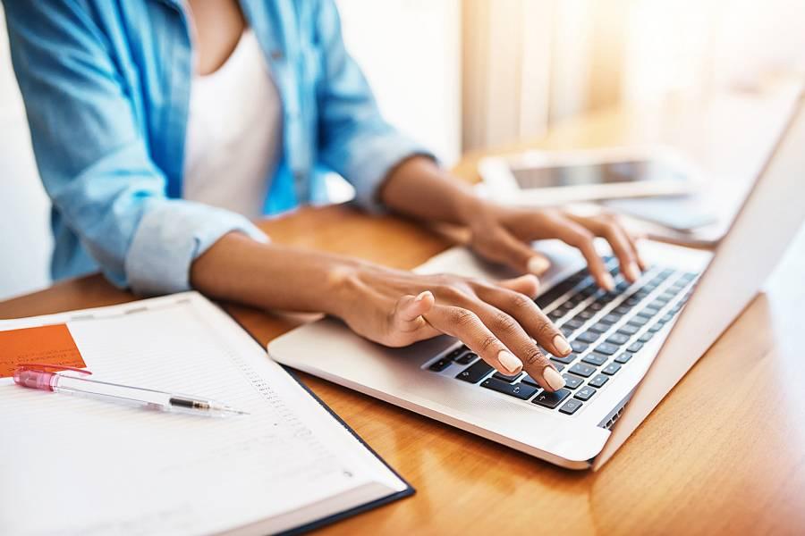 Woman's hands on laptop keyboard