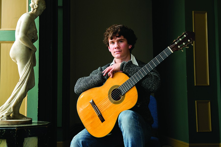 Peabody student Oscar Somersalo with the Fleta guitar