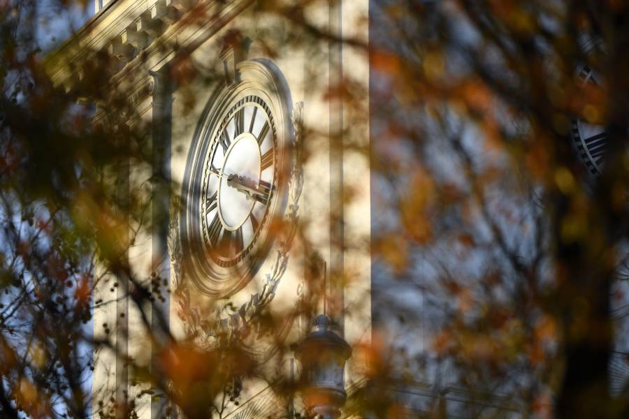 Gilman clock tower clock face with fall leaves