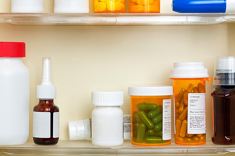 Bottles of prescription drugs on a medicine cabinet shelf