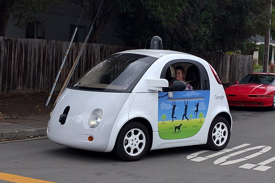 A woman sits in a Google self-driving car