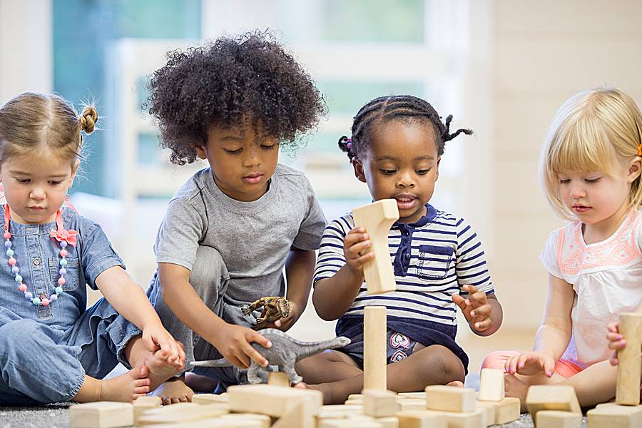 Toddlers playing with building blocks