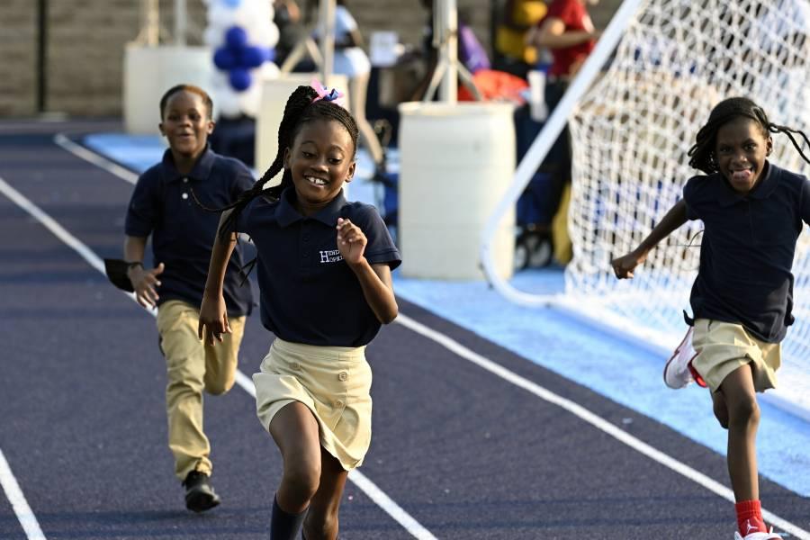 Children running on track at Henderson-Hopkins