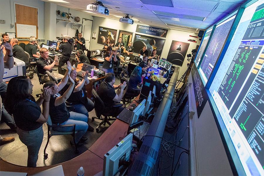 New Horizons flight controllers celebrate