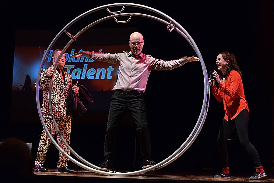 2017 judge Thomas Dolby tries out the gymnast wheel of winner Amanda Gatewood, right, as emcee Ian Reynolds looks on