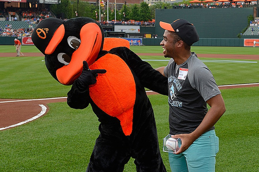 The Orioles mascot welcomes Greg Burks of Johns Hopkins to Hopkins Night at Camden Yards in 2017