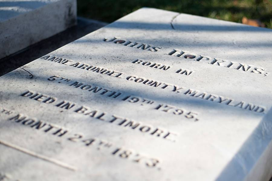 The tombstone marking the birth of Johns Hopkins on May 19, 1795, and his death on Dec. 24, 1873.