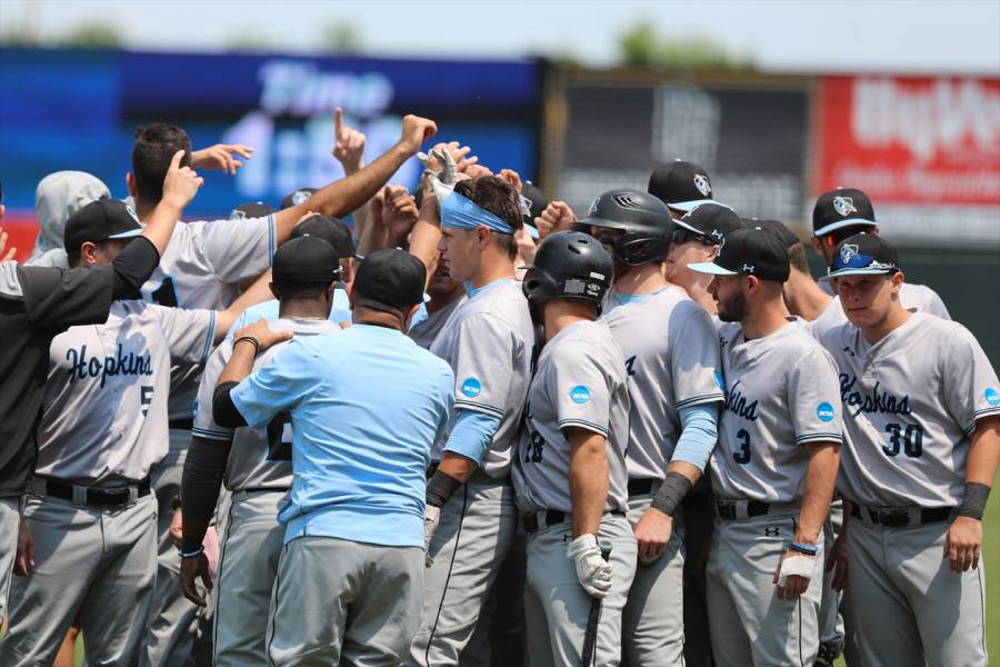 Johns Hopkins baseball team huddles after a game