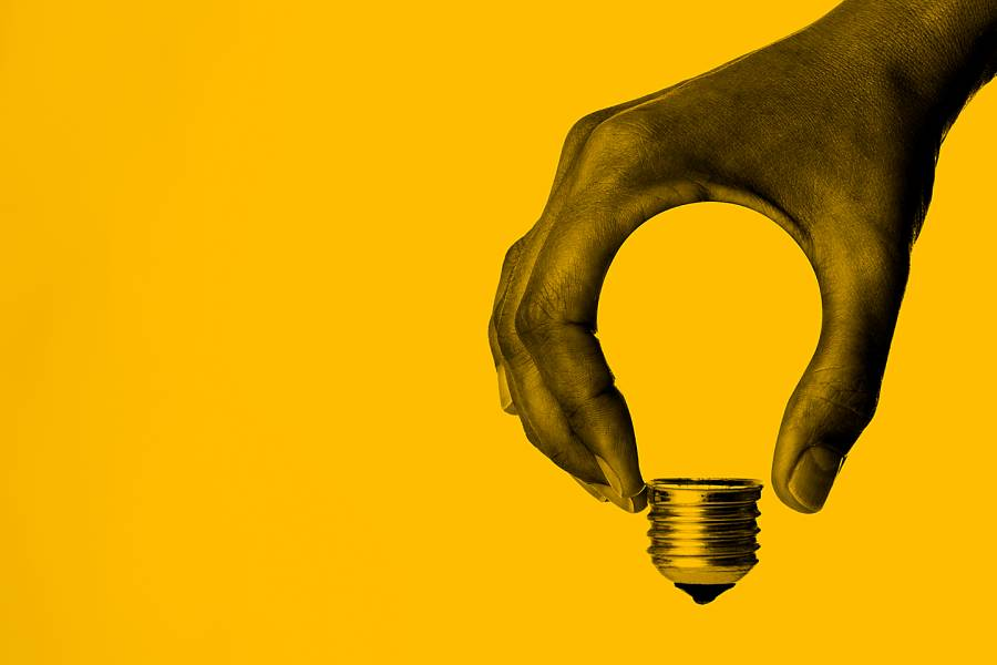 Abstract image of hand holding a lightbulb