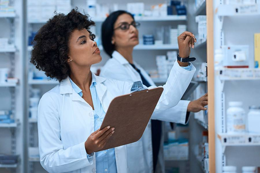 Two female pharmacists looking at their medications
