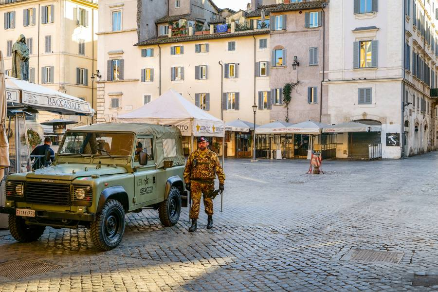 A member of the Italian army guards Piazza Campo de Fiori, which appears almost completely deserted amid the coronavirus outbreak