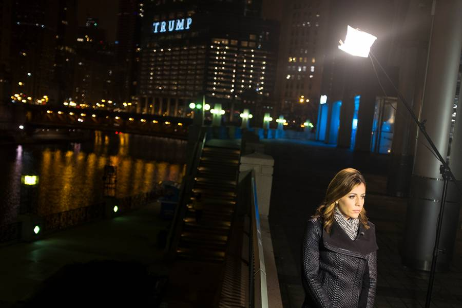 Reporter Hallie Jackson stands in front of a camera with Trump Tower in the background