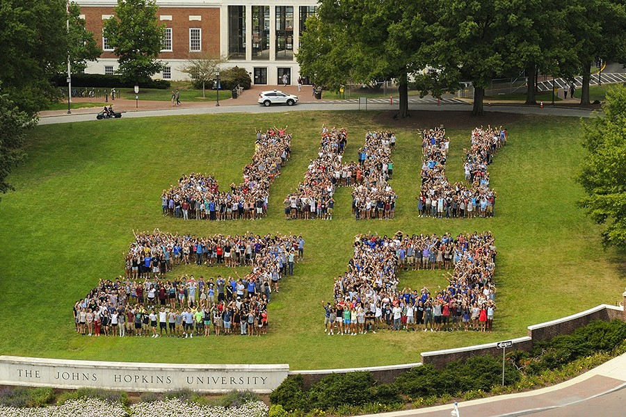 First-year students arrange themselves to spell 'JHU 20'