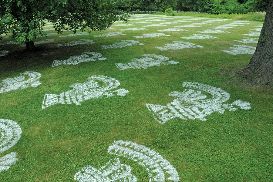 Lawn is spray painted with Aztec-inspired designs
