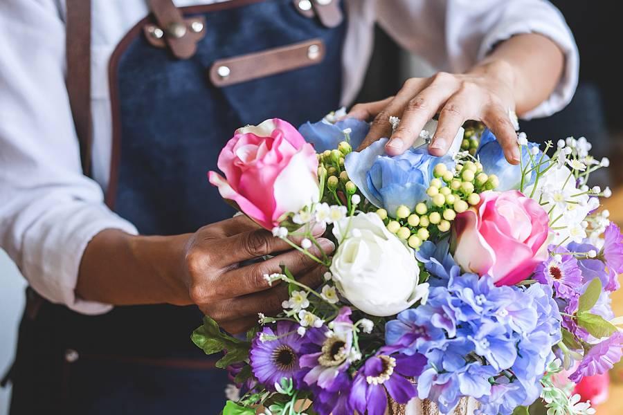 Florist arranging a bouquet of colorful flowers