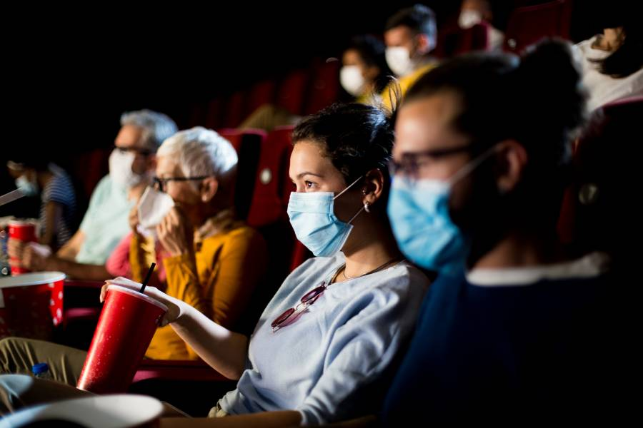 People wearing face masks in a movie theater