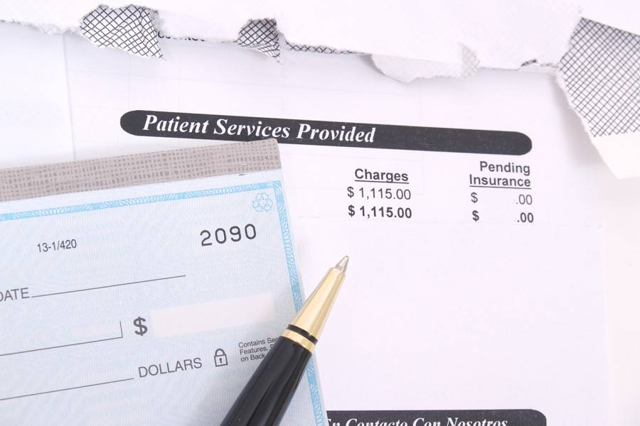 A checkbook and medical bill