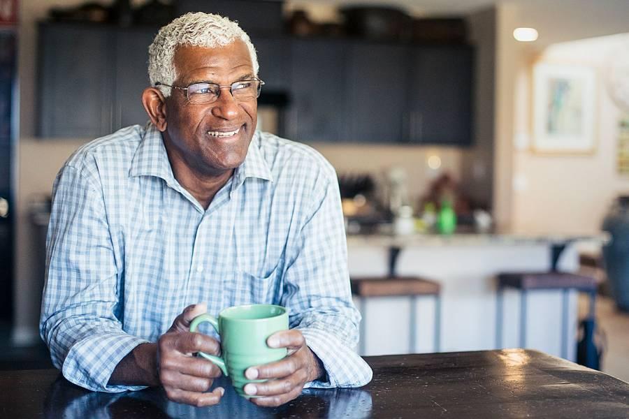 Smiling senior man in his kitchen