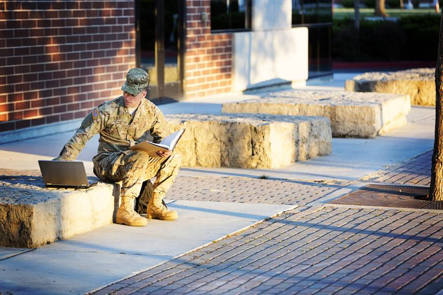 Soldier with laptop and notebook