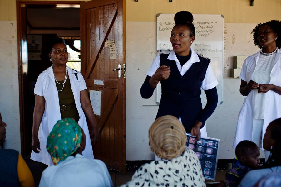 Molly Rammipi talks to patients at the Mandiba Clinic in Botswana