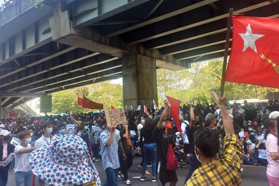 Protesters swarm a bridge in Myanmar's largest city, Yangon