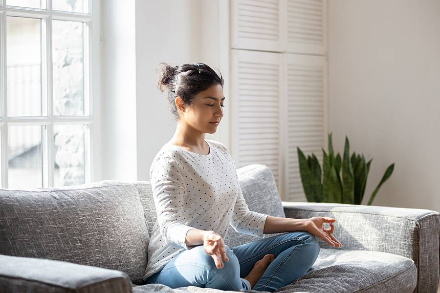 Woman on couch meditating