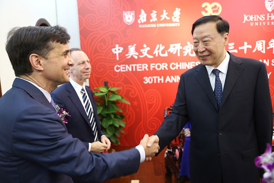 JHU President Ronald J. Daniels and Chen Deming, former Chinese Minister of Commerce, shake hands