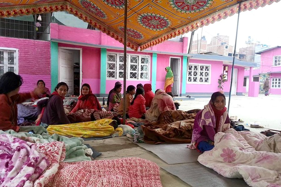 Women gather under a tent in Nepal