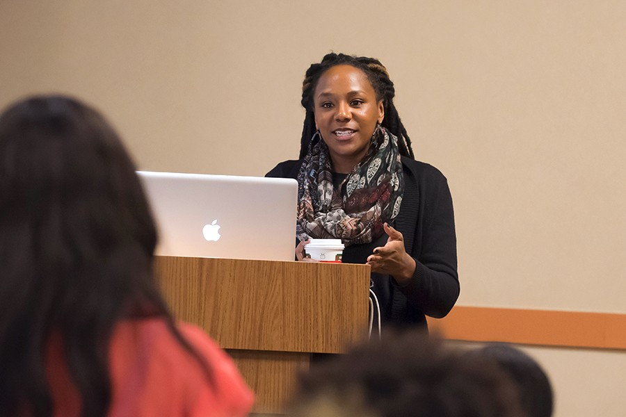 Bree Newsome, at podium, addresses a student